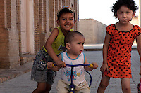 Group portrait of children playing in Ichan Kala, the old city, Khiva, Uzbekistan, pictured on July 5, 2010, in the afternoon. Khiva, ancient and remote, is the most intact Silk Road city. Ichan Kala, its old town, was the first site in Uzbekistan to become a World Heritage Site(1991). Picture by Manuel Cohen.