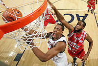 Virginia's Jerome Meyinsse_Virginia held North Carolina State scoreless for more than 7 minutes on the way to a 59-47 victory Wednesday night at the John Paul Jones Arena in Charlottesville, VA. Virginia (14-6, 5-2 Atlantic Coast Conference) regained a share of first place in the conference. (Photo/Andrew Shurtleff)....
