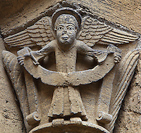 Carved capital depicting an angel holding a scroll, on the external wall of the South ambulatory of the Abbatiale Sainte-Foy de Conques or Abbey-church of Saint-Foy, Conques, Aveyron, Midi-Pyrenees, France, a Romanesque abbey church begun 1050 under abbot Odolric to house the remains of St Foy, a 4th century female martyr. The church is on the pilgrimage route to Santiago da Compostela, and is listed as a historic monument and a UNESCO World Heritage Site. Picture by Manuel Cohen