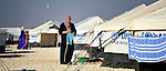 A woman hangs out laundry to dry in the Zaatari Refugee Camp, located near Mafraq, Jordan. Opened in July, 2012, the camp holds upwards of 50,000 refugees from the civil war inside Syria, but its numbers are growing. International Orthodox Christian Charities and other members of the ACT Alliance are active in the camp providing essential items and services.
