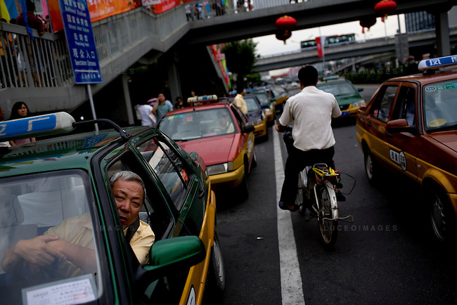 Taxis wait for fans to exit the Olympic venues in Beijing, China on Sunday, August 17, 2008.  Kevin German