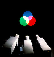 MIXING LIGHT PRIMARIES TO MAKE WHITE LIGHT<br /> Showing projectors<br /> Red, blue and green projected light combine to form secondary colors and white light where all three overlap.