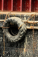 Don't scratch my paint work!  Buffer tyre on barge in Victoria Harbor, Hong Kong