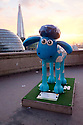 London, UK. 07.04.2015. Shaun the Sheep, charity sculpture, Tower Bridge, London, UK. Globetrotter. Photograph © Jane Hobson.