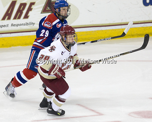 Derek Arnold (Lowell - 29), Tommy Atkinson (BC - 28) - The Boston College Eagles defeated the visiting University of Massachusetts-Lowell River Hawks 5-3 (EN) on Saturday, January 22, 2011, at Conte Forum in Chestnut Hill, Massachusetts.