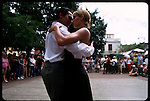 Argentina is known for it's tango. Nobody knows when and where tango was first played but the music, the songs, and the dance go back to Buenos Aires brothels where Spanish, Italian, Eastern European immigrants and blacks met in the 1880's. From the brothels tango moved to the salons and richer residents of Buenos Aires who ignored it's brothel's origins and the dance's black roots. By the beginning of the 20th century tango became a very white European affair. Here tango dancers perform for a crowd in the San Telmo square of Buenos Aires.