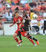 Sainey Nyassi (27) of D.C. United goes against Darren O'dea (48) of Toronto FC. Toronto FC defeated D.C. United 2-1, at RFK Stadium, Saturday June 15 , 2013.