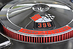 Bellmore, New York, USA. May 29, 2015. 396 Turbo Jet 375 HP big-block engine, with red black and white Crossed Flags emblem shows under hood of 1970 Chevrolet Chevelle SS, owned by Steve Russo of Lindenhurst, is on view at the Friday Night Car Show held at the Bellmore Long Island Railroad Station Parking Lot. Hundreds of classic, antique, and custom cars are generally on view at the free weekly show, sponsored by the Chamber of Commerce of the Bellmores, from May to early October.