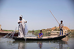 ABU AL-NRSI, IRAQ: Mhebis goes fishing with his two sons. His family was displaced after living in Fallujah for 13 years...Dozens of families displaced by years of violence have been forced to return to the district of Chebaish...Photo by Ali Arkady/Metrography
