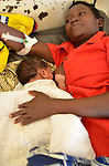 A mother with her newborn baby feeding in the maternity ward in Nayagatare Hospital, Rwanda....