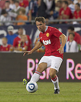 Manchester United FC forward Michael Owen (7) passes the ball. In a Herbalife World Football Challenge 2011 friendly match, Manchester United FC defeated the New England Revolution, 4-1, at Gillette Stadium on July 13, 2011.