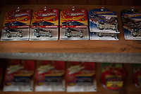 Reinholds, Pennsylvania, February 10, 2015 - A collection of AMC Gremlin Hot Wheels in their original packaging hangs from the rafters of Brian Moyer's garage. <br /> <br /> Moyer owns 16 AMC Gremlins. The Gremlin was introduced on April Fools Day (April 1) in 1970 featuring a shortened Hornet body with a Kammback tail and was manufactured in the US via AMC and in Mexico via AMC's subsidiary VAM. It's lifecycle ended in 1978 when it was replaced by the AMC Spirit. Moyer became interested as a kid when he saw the early Gremlin commercials in 1970. His first car was a Gremlin and he has never not owned one. Today he has arguably the most unique collection of Gremlins in the world, including several that are one-of-a kind models. <br /> <br /> CREDIT: Daryl Peveto for The Wall Street Journal<br /> Photo Assignment ID: 36892 <br /> Slug: MYRIDE_Gremlin