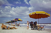 Little girl on the beach with her family 1962 - Myrtle Beach S.C