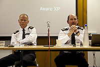 Bob Broadhurst and Chris Allison, Metropolitan police - 2012 <br /> <br /> London, 11/04/2012, Friend's House, Euston road. Today a meeting was organised by the NUJ (National Union of Journalists) Freelance Office to discuss the plans for policing the London 2012 Olympic Games. The speakers included: Chris Allison (Assistant Commissioner with the Metropolitan Police and National Olympic Security Coordinator) and Bob Broadhurst (Commander and 2012 Olympics Gold Command for the Metropolitan Police). Chair of the event was Michelle Stanistreet (NUJ General Secretary).