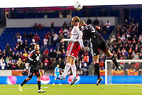 Joel Lindpere (20) of the New York Red Bulls goes up for a header with Robbie Russell (3) of D. C. United. D. C. United defeated the New York Red Bulls 1-0 (2-1 in aggregate) during the second leg of the MLS Eastern Conference Semifinals at Red Bull Arena in Harrison, NJ, on November 8, 2012.