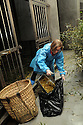 JOURNALIST HAZEL SOUTHAM MUCKING OUT PANDA ENCLOSURES AS PART OF A HALF DAY VOLUNTARY EXPERIENCE AT THE CHENGDU PANDA BREEDING AND RESEARCH CENTRE, SICHUAN, CHINA. 14/3/13. PICTURE BY CLARE KENDALL 07971 477316