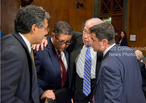 United States Senator Chuck Grassley (Republican of Iowa), Chairman, US Senate Committee on the Judiciary, right center, huddles with the three nominees who will appear before the Committee on their nominations to US Department of Justice positions on Capitol Hill in Washington, DC on Wednesday, May 10, 2017.  From left to right: Noel J. Francisco, Solicitor General of the US-designate; Makan Delrahim, Assistant Attorney General, Antitrust Division of the US Department of Justice-designate; Senator Grassley; and Steven A. Engel as Assistant Attorney General, Office of Legal Counsel, US Department of Justice-designate.<br /> Credit: Ron Sachs / CNP