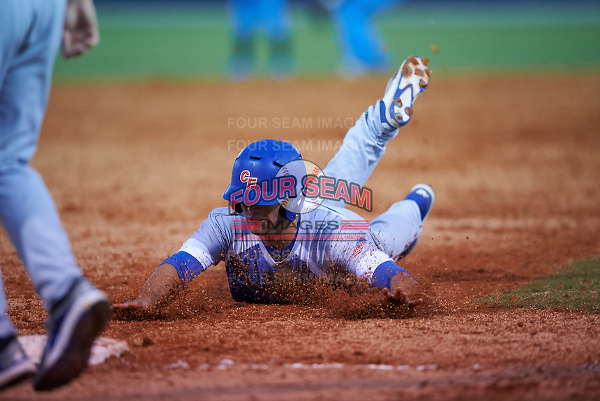 College of Central Florida Patriots Micah Byrd (28) slides head first into third during a game against the SCF Manatees on February 8, 2017 at Robert C. Wynn Field in Bradenton, Florida.  SCF defeated Central Florida 6-5 in eleven innings.  (Mike Janes/Four Seam Images)