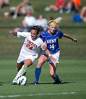 Danielle Colaprico (24) of Virginia fights for the ball with Erin Koballa (14) of Duke during the game at Klockner Stadium in Charlottesville, VA.  Virginia defeated Duke, 1-0.