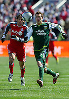 26 March 2011: Toronto FC forward Alan Gordon #21 and Portland Timbers defender Eric Brunner #5 in action during an MLS game between the Portland Timbers and the Toronto FC at BMO Field in Toronto, Ontario Canada..Toronto FC won 2-0....