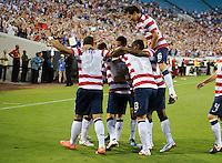 Jacksonville, FL - Saturday, May 26, 2012: Landon Donovan is congratulated after scoring his first of 3 goals as the USMNT defeated Scotland 5-1 during an international friendly match.