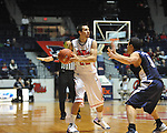 "Ole Miss' Marshall Henderson (22) vs. East Tennessee State's Mario Stramaglia (3) at the C.M. ""Tad"" Smith Coliseum in Oxford, Miss. on Saturday, December 14, 2012. Mississippi won 77-55 to improve to 7-1. (AP Photo/Oxford Eagle, Bruce Newman).."