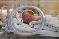 A 5 weeks premature baby lies into an incubator