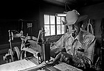 Modesto, California, June, 1975.80-year old Jess Tharp had been making and repairing saddles since 1922.  He change careers from full time cowboy to working in a saddletree shop in Utah after he returned from World War I.  In Jess's south Modesto shop he restored a saddle mad by Main & Winchester of San Francisco in the 1880s.  He use this saddle on his mare to ride in the 1975 4th of July parade in Modesto. .Photo By Al Golub/Golub Photography