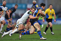 Tom Heathcote of Worcester Warriors is tackled by Jonathan Evans of Bath Rugby. Aviva Premiership match, between Worcester Warriors and Bath Rugby on February 13, 2016 at Sixways Stadium in Worcester, England. Photo by: Patrick Khachfe / Onside Images