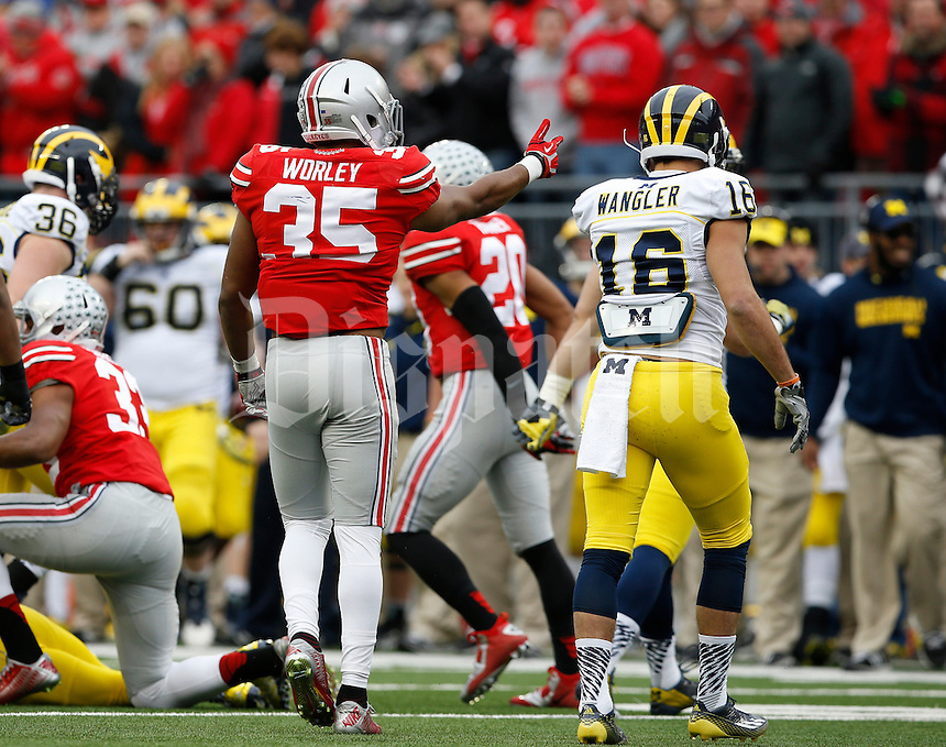 Ohio State Buckeyes safety Chris Worley (35) makes a hand gesture toward Michigan Wolverines wide receiver Jack Wangler (16) on a kickoff during the 4th quarter of the NCAA football game at Ohio Stadium on Nov. 29, 2014. (Adam Cairns / The Columbus Dispatch)