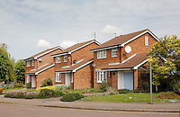 Three Pantile and brick two storey detached houses in a housing development in Rosedale Av, Stonehouse, Gloucestershire