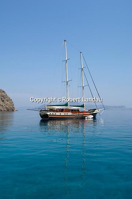Wooden touring boat on the Mediterranean Sea near Simi, Greece