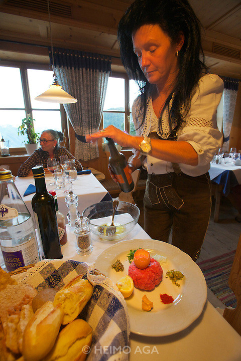 South Tyrol. Toblach/Kandellen (Dobbiaco/Gandelle). Seiterhof restaurant and hotel. Beef Tartare from the farm's own Angus Beef, prepared by Mrs. Kamelger.