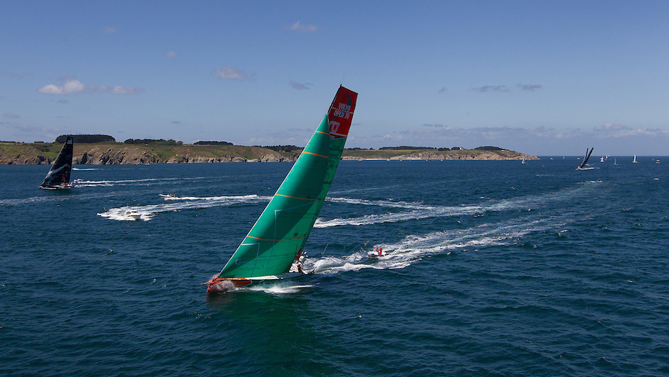 FRANCE, Belle Ile. 1st July 2012. Volvo Ocean Race, Leg 9 Lorient-Galway. Groupama Sailing Team with PUMA Ocean Racing powered by BERG in the distance.