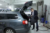Police officer Morten Haukeland puts abulletproof vest in his unmarked police car before starting a patrol.<br /> <br /> Morten Haukeland legger en skuddsikker vest i bilen.  Sentrum Politistasjons etteretningsavdeling f&oslash;lger med p&aring; utelivet i Oslo sentrum. . (Foto:Fredrik Naumann/Felix Features)