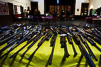New Jersey, United States. 15th February 2013 -- Tagged weapons are seen on a table after being acquired during the Gun Buyback program in New Jersey. Photo by Eduardo Munoz Alvarez / VIEWpress.