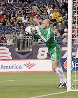 New England Revolution goalkeeper Preston Burpo (24) saves a goal during a free kick.  The New England Revolution drew FC Dallas 1-1, at Gillette Stadium on May 1, 2010