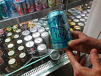 A shopper chooses a can of LaCroix sparkling water in a deli in New York on Monday, July 4, 2016. LaCroix eschews traditional advertising instead relying on their manipulation of social media to attract their millennial demographic. Sales have gone from $65 million in 2010 to $226 million in 2015 making it the number brand of flavored sparkling water in the U.S. (© Richard B. Levine)