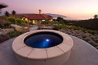 The outside yard of a private residence in California overlooking the ocean.