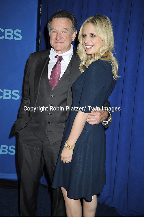 "Robin Williams and Sarah Michelle Gellar of ""The Crazy Ones"" attend the CBS Prime Time 2013 Upfront on May 15, 2013 at Lincoln Center in New York City."