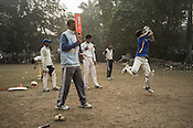 Balram Singh (left) coaches young cricketers from the Calcutta Parsee Club during their regular practice session at the maidan in Kolkata, West Bengal, India.
