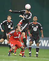 Branko Boskovic #27 of D.C. United heads over Nick LaBrocca #21 of Toronto FC during an MLS match that was the final appearance of D.C. United's Jaime Moreno at RFK Stadium, in Washington D.C. on October 23, 2010. Toronto won 3-2.
