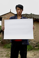 Zhang Xiang Yun - 24 Yrs.<br /> Just returned to village from migrant construction work.<br /> Gansu Province.<br /> <br /> (Illiterate) I want the economic development of the village to be better and faster'..
