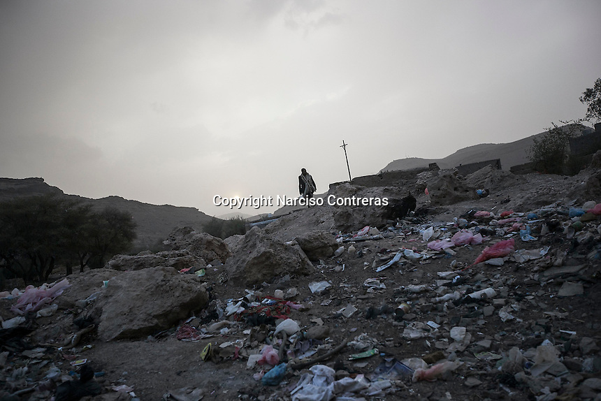Wednesday 15 July, 2015: A local villager walks in the sunset at the entrance of the abandoned salafist madrasa (university) where 7000 students used to live and learn in Dammaj village is now used as temporary shelter for the displaced families from the heavy fighting and bombarments in Sa'dah governorate in the northern province of Sa'dah, the stronghold of the Houthi's movement in Yemen. (Photo/Narciso Contreras)