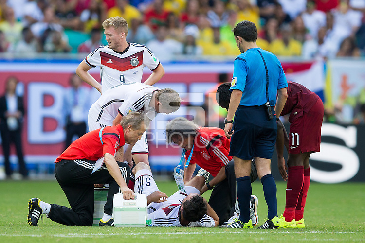 Mats Hummels of Germany is seen by medics and shortly taken off the pitch