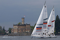 Mads Ebler and Paolo Cian sail past Castle Montfort on day 2 of Match Race Germany. World Match Racing Tour. Langenargen, Germany. 21 May 2010.