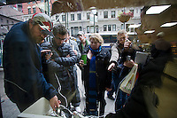 A 7-Eleven store set up charging stations outside its store for people to charge their cell phones in midtown in New York on Wednesday, October 31, 2012. Con Edison is estimating electricity will not be restored back to Lower Manhattan for several more days and a number of businesses are allowing people to charge their batteries.  (© Frances M. Roberts)