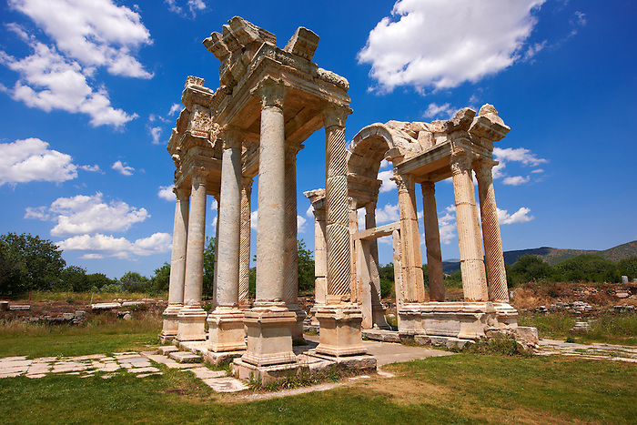 """Picture of the double Tetrapylon Gate 1, Aphrodisias, Turkey. A tetrapylon (Greek: Τετράπυλον, """"four gates"""") is an ancient type of Roman monument of cubic shape, with a gate on each of the four sides: generally it was built on a crossroads. stock photos & photo art prints."""