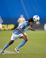 North Carolina defender Sheanon Williams (20)  heads the ball.  North Carolina Tar Heels defeated Wake Forest Demon Deacons 1-0 in the semifinal match of the NCAA Men's College Cup at Pizza Hut Park in Frisco, TX on December 12, 2008.  Photo by Wendy Larsen/isiphotos.com