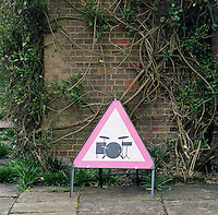 A humorous sign in the grounds of Daisy Lowe's country house in Hampshire